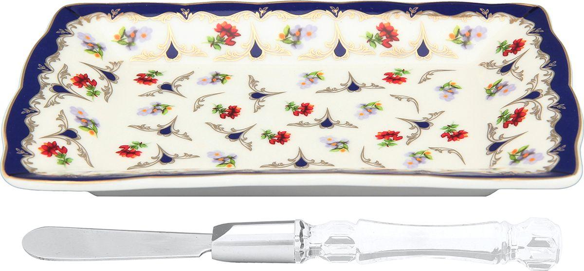 Тарелка под масло Elan Gallery Цветочек, с ножом, 17 х 10,5 х 2 см. 504158504158Тарелка для масла предназначена для сервировки масла. Идеально подходит для сервировки завтраков и чаепитий. В комплекте нож. Яркий узор никого не оставит равнодушным и приятно удивит гостей.