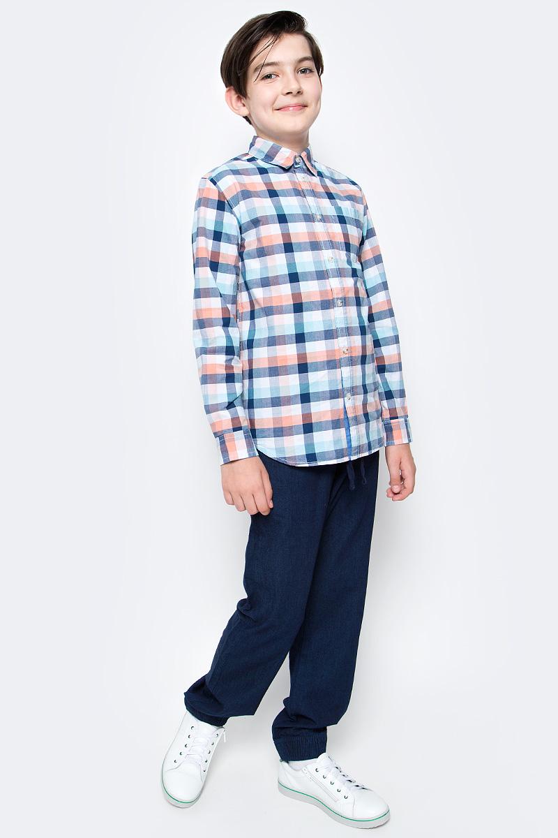 Рубашка для мальчика Sela, цвет: белый, синий, оранжевый. H-812/179-7121. Размер 140, 10 летH-812/179-7121Рубашка для мальчика Sela выполнена из натурального хлопка. Рубашка с длинными рукавами и отложным воротником застегивается на пуговицы спереди. Манжеты рукавов также застегиваются на пуговицы. Рубашка оформлена принтом в клетку. На груди расположен накладной карман.