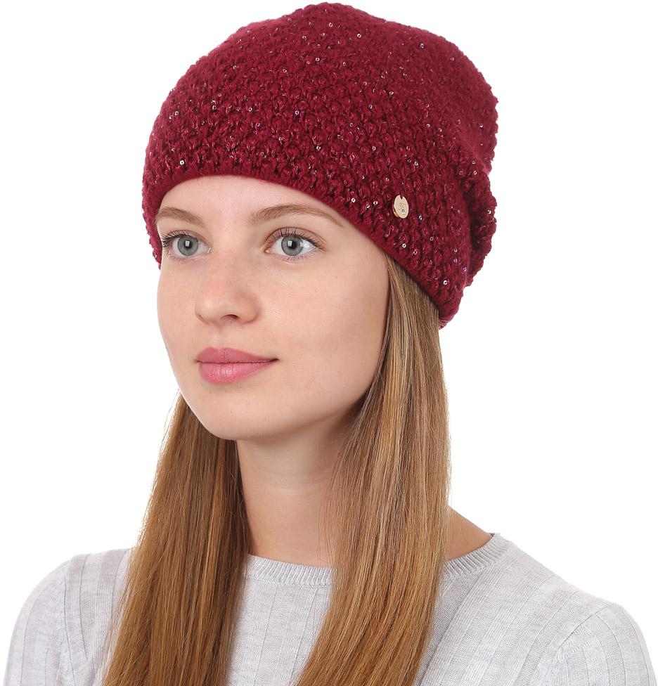 Шапка женская Fabretti, цвет: бордовый. F2017-3-26. Размер универсальныйF2017-3-26Стильная женская шапка Fabretti отлично дополнит ваш образ и защитит от холода. Смесовая пряжа с шерстью в составе максимально сохраняет тепло и обеспечивает удобную посадку. Классическая вязаная шапка оформлена металлическим декоративным элементом. Такая шапка станет отличным дополнением к вашему осеннему или зимнему гардеробу, в ней вам будет уютно и тепло!