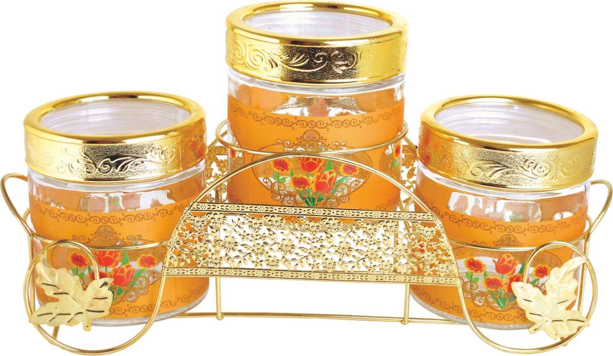 Набор банок для сыпучих продуктов Queen Ruby, 4 предмета. QR-6073QR-6073Набор Queen Ruby состоит из трех банок одного объема, предназначенных для хранения сыпучих продуктов, а также в набор входит стильная подставка из нержавеющей стали. Изделия выполнены из высококачественного стекла и декорированы изображением цветов. Закручивающиеся крышки оснащены пластиковыми вставками, которые позволяют герметично закрывать емкости и сохранить свежесть продуктов. Банки прекрасно подходят для круп, орехов, сухофруктов, чая, кофе, сахара и многого другого.Оригинальный и необычный дизайн набора Queen Ruby прекрасно впишется в интерьер вашей кухни. А также станет желанным подарком для любой хозяйки.