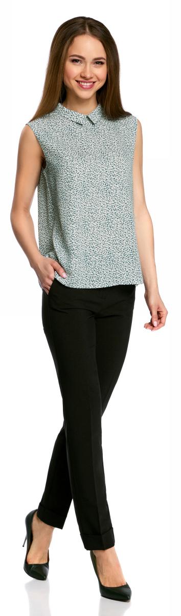 Блузка женская oodji Ultra, цвет: зеленый, белый. 11411084B/43414/6210F. Размер 38-170 (44-170)11411084B/43414/6210FЛегкая блузка прямого кроя без рукавов с воротником под горло. Особенности этой модели – глубокий вырез-капля с застежкой на крючки на спинке и небольшой округлый отложной воротничок. Блузка прямого силуэта из эластичной ткани отлично сидит и не стесняет движений. Маленькая блузка, по сути топ, – настоящая находка для любителей минимализма в одежде. С ней можно создать множество интересных образов – от строгих деловых до повседневных в стиле casual.