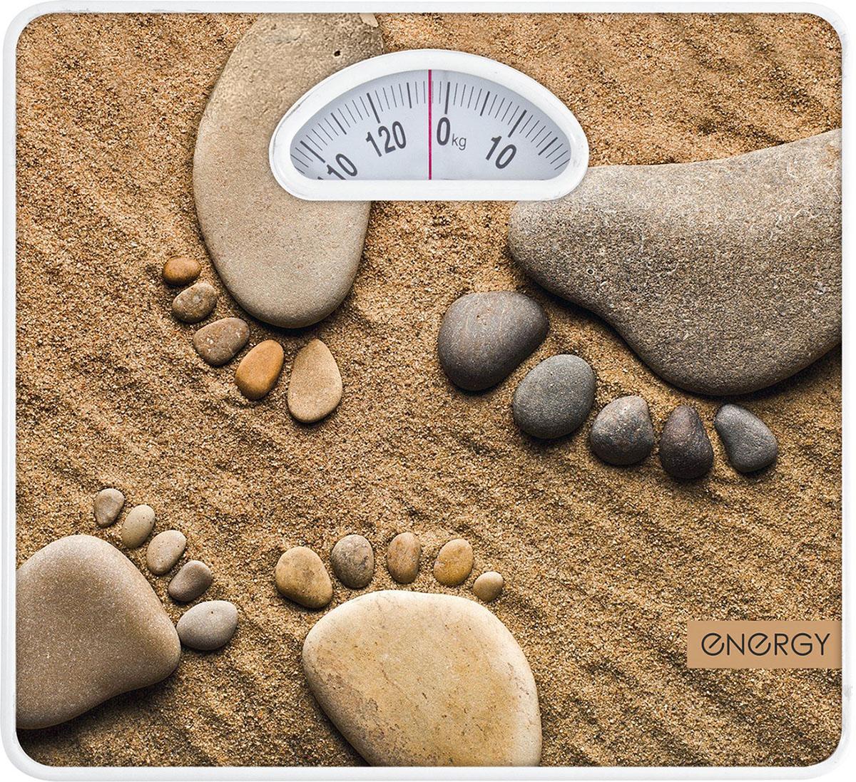 Energy ENМ-408D напольные весы54 003115Напольные механические весы Energy ENМ-408D - неотъемлемый атрибут здорового образа жизни. Они необходимытем, кто следит за своим здоровьем, весом, ведет активный образ жизни, занимается спортом и фитнесом. Оченьудобны для будущих мам, постоянно контролирующих прибавку в весе, также рекомендуются родителям,внимательно следящим за весом своих детей.Надежный механизм Крупный шрифт надписей на шкале Цена деления: 1 кг