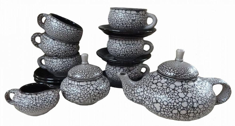 Набор чайный Борисовская керамика Орнамент. МРМ00000815545-779Чайный набор Орнамент прекрасно подойдет для вашей кухни и великолепно украсит стол. Изящный лаконичный дизайн и красочность оформления изделий придутся по вкусу и ценителям классики, и тем, кто предпочитает утонченность и изысканность в дизайне. Все изделия изготавливаются на современном оборудовании по новейшим технологиям и проходят строгий контроль качества. Состав: чайник 0,7 л - 1 шт, сахарница 0,35 л - 1 шт, сливочник 0,18 л - 1 шт, чашка с блюдцем 0,25 л - 6 шт.