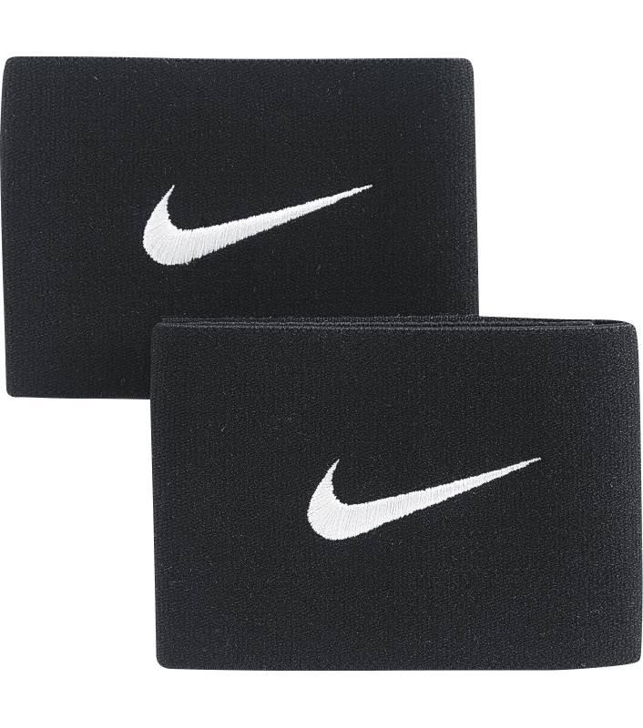 Фиксатор для щитков Nike Guard II, цвет: черныйSE0047-001Фиксатор для щитков Nike Guard II надежно удерживает их на голени, позволяя сосредоточиться на игре от первого до последнего момента. Быстрое переодевание благодаря ремешку с застежкой-липучкой. Эластичная конструкция для дополнительной поддержки. Надеваются поверх щитков или под ними для дополнительной защиты. Большой логотип Nike в верхней части.