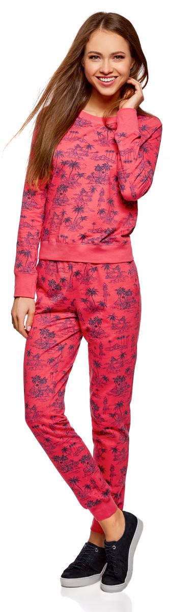Брюки для дома женские oodji Ultra, цвет: ярко-розовый, фиолетовый, графика. 16701042/46919/4D83G. Размер S (44)16701042/46919/4D83GЭффектные домашние брюки oodji Ultra на эластичном ремне с завязками выполнены из натурального хлопка и оформлены ярким принтом. Модель зауженного силуэта с широкими манжетами мягко облегает фигуру и стройнит. Трикотаж приятен на ощупь, немного тянется и комфортен в ношении. Модель зауженного силуэта хорошо смотрится на разных фигурах.