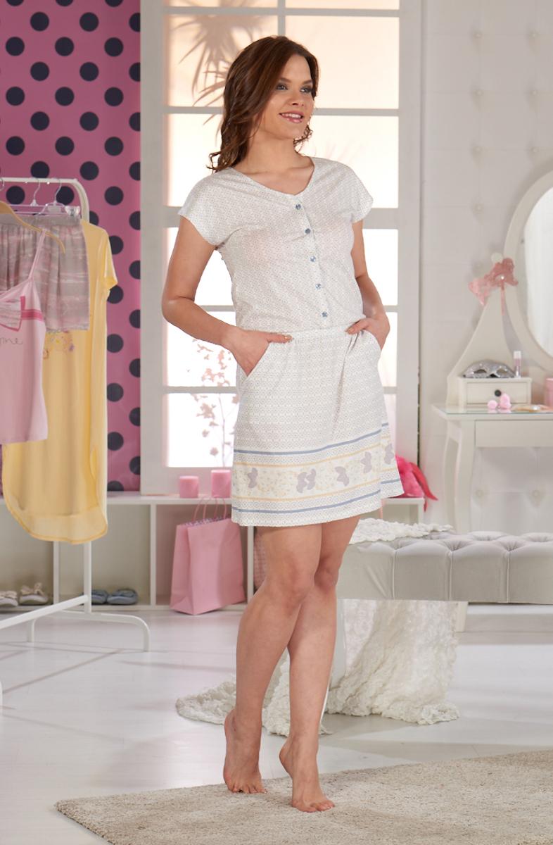 Платье домашнее Sevim, цвет: сиреневый. 10309 SV. Размер XL (48/50)10309 SVДомашнее платье Sevim выполнено из мягкого трикотажа. Модель с круглым вырезом горловины и короткими рукавами на груди застегивается на пуговицы. Изделие с отрезной линией талии дополнено двумя боковыми карманами. Платье красиво смотрится, идеально сидит, дарит легкость, свободу движениям и оптимальный комфорт в процессе носки.