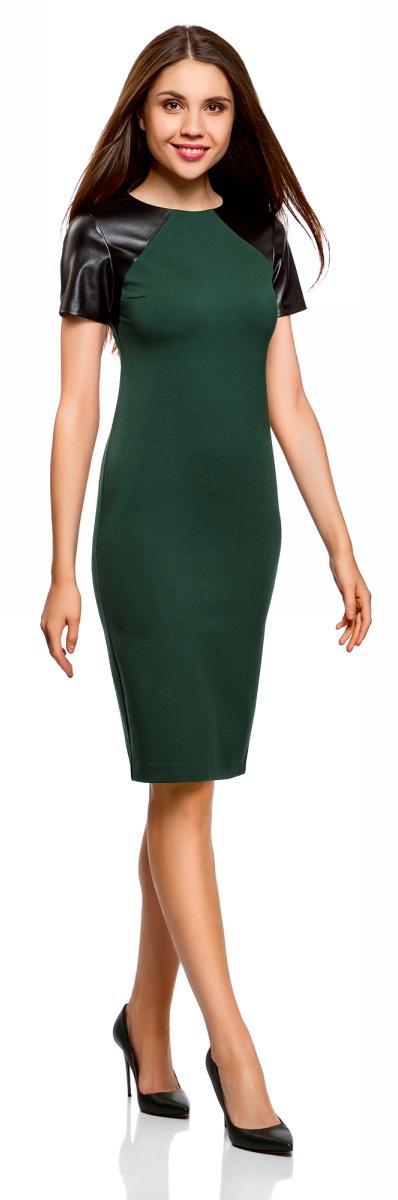 Платье oodji Collection, цвет: темно-изумрудный, черный. 24011018/43060/6E29B. Размер XL (50)24011018/43060/6E29BЛаконичное платье oodji Collection выполнено из плотного трикотажа со вставками из искусственной кожи. Модельсредней длины застегивается на скрытую молнию на спинке и дополнена разрезом на юбке. Платье облегающего кроя подчеркивает достоинства фигуры и стройнит ноги. Модель подойдет для офиса, учебы, свидания или встречи с подругами и станет отличным дополнением повседневного гардероба.