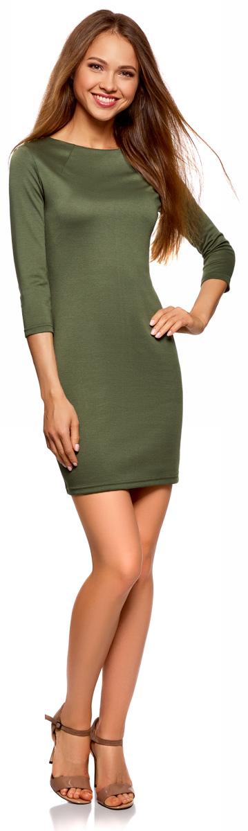 Платье oodji Ultra, цвет: темно-зеленый. 14001105-2/18610/6900N. Размер M (46)14001105-2/18610/6900NКороткое трикотажное платье приталенного силуэта с эффектным металлическим декором на плечах. Вырез-лодочка акцентирует внимание на линии шеи. Спереди от выреза в стороны отходят две небольшие вытачки. Рукава 3/4 красиво подчеркивают руки. Платье застегивается сзади на короткую молнию, которая выполняет и декоративную функцию. Плотная трикотажная ткань эластична и хорошо тянется, приятно облегает силуэт. Платье отлично сидит и комфортно в ношении. Женственное короткое платье прекрасно подойдет для особенных случаев.