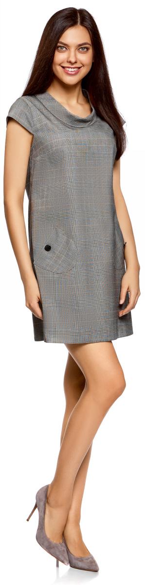 Платье oodji Ultra, цвет: черный, белый. 12C03001-1/46961/2912O. Размер 38-170 (44-170)12C03001-1/46961/2912OСтильное платье прямого кроя с короткими рукавами. У модели небольшой воротник-хомут и два накладных закругленных кармана на пуговицах. Короткое платье прямого силуэта красиво сидит на любой фигуре.