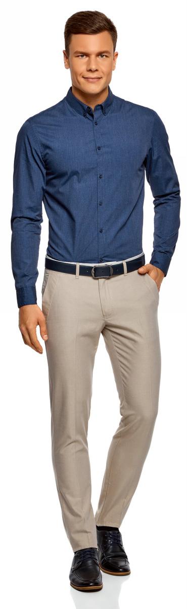 Рубашка мужская oodji Lab, цвет: синий, черный, графика. 3L310152M/47121N/7529G. Размер M-182 (50-182)3L310152M/47121N/7529GСтильная рубашка oodji Lab с длинным рукавом выполнена из хлопка с добавлением полиэстера и оформлена мелким графическим принтом. Классический отложной воротничок с острыми углами на пуговицах, манжеты с пуговицами, застежка на пуговицы спереди по всей длине. У рубашки слега приталенный силуэт, ее можно носить заправленной или навыпуск. В такой рубашке комфортно в течение всего дня. Элегантная рубашка станет основой для делового гардероба. Она хорошо сочетается с прямыми и зауженными брюками. Для создания строгого образа рубашку можно дополнить классическим или спортивным пиджаком, или же в качестве второго слоя выбрать трикотажный кардиган. С этой рубашкой вы можете создать разные деловые луки. Они всегда будут отвечать строгому дресс-коду. Из обуви предпочтение рекомендуется отдавать классическим моделям туфель.