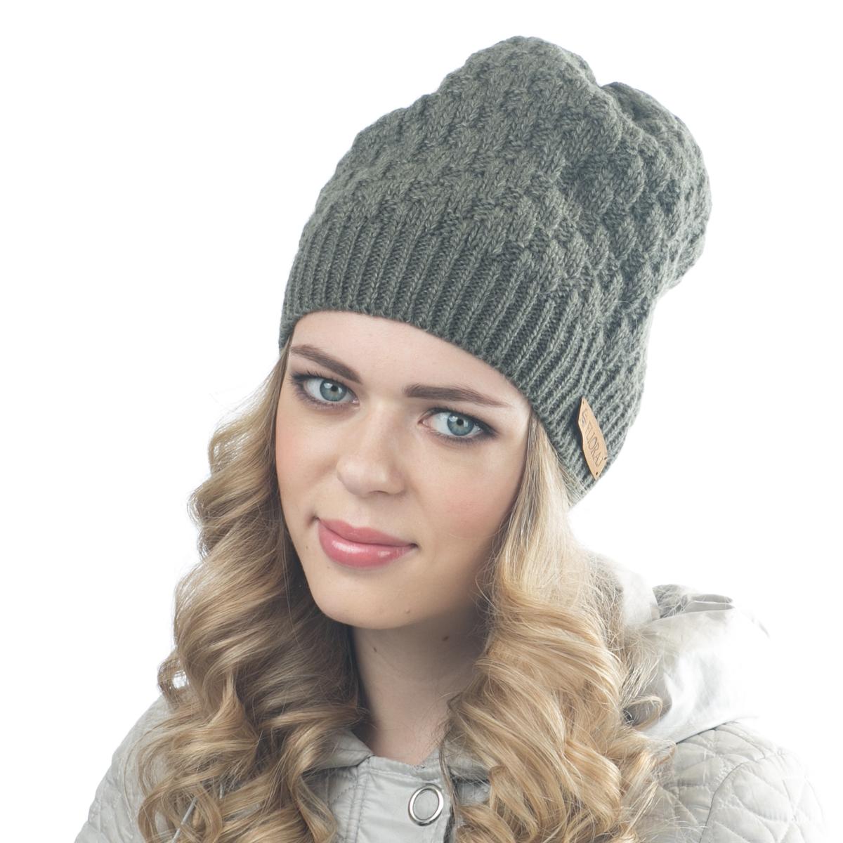 Шапка женская Flioraj, цвет: зеленый. 01FJ. Размер 56/5801FJТеплая шапка от Flioraj, связанная из овечьей шерсти и шерсти горной альпаки, отлично согреет в холодную погоду. Состав пряжи делает изделие мягким, теплым и комфортным. Модель выполнена крупной рельефной вязкой и украшена нашивкой из натуральной кожи.
