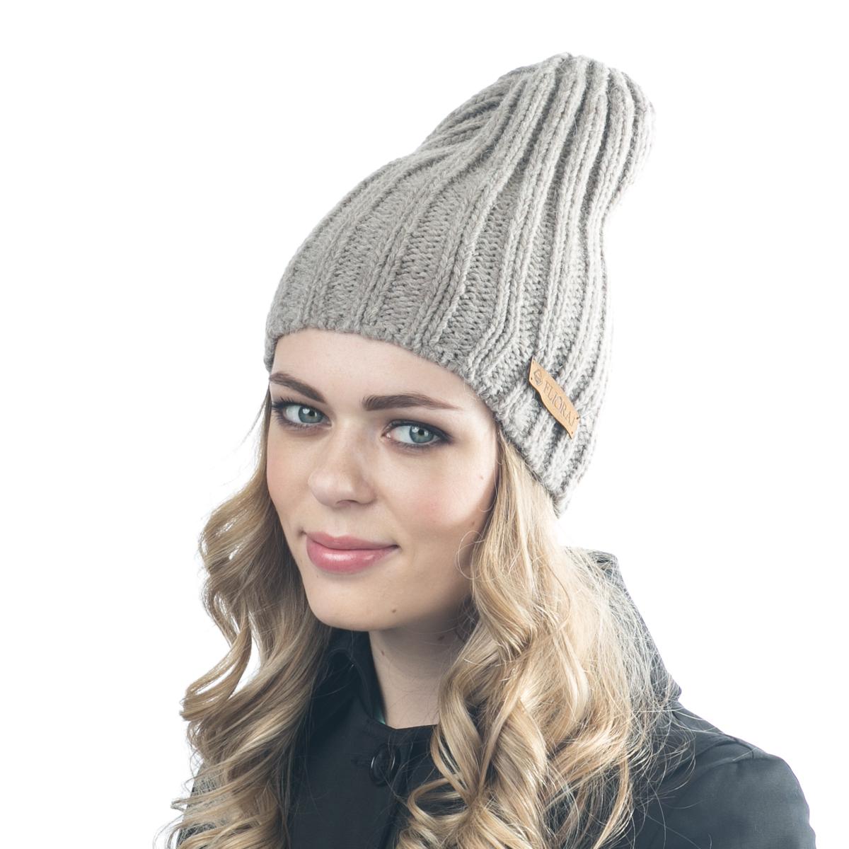 Шапка женская Flioraj, цвет: темно-бежевый. 06FJ. Размер 56/5806FJСтильная шерстяная шапка-колпачок от Flioraj, выполненная из шерсти с добавлением вискозы и полиакрила, отлично согреет в холодную погоду. Состав пряжи делает изделие мягким, теплым и комфортным. Модель выполнена актуальной резинкой, сбоку дополнена нашивкой из натуральной кожи.