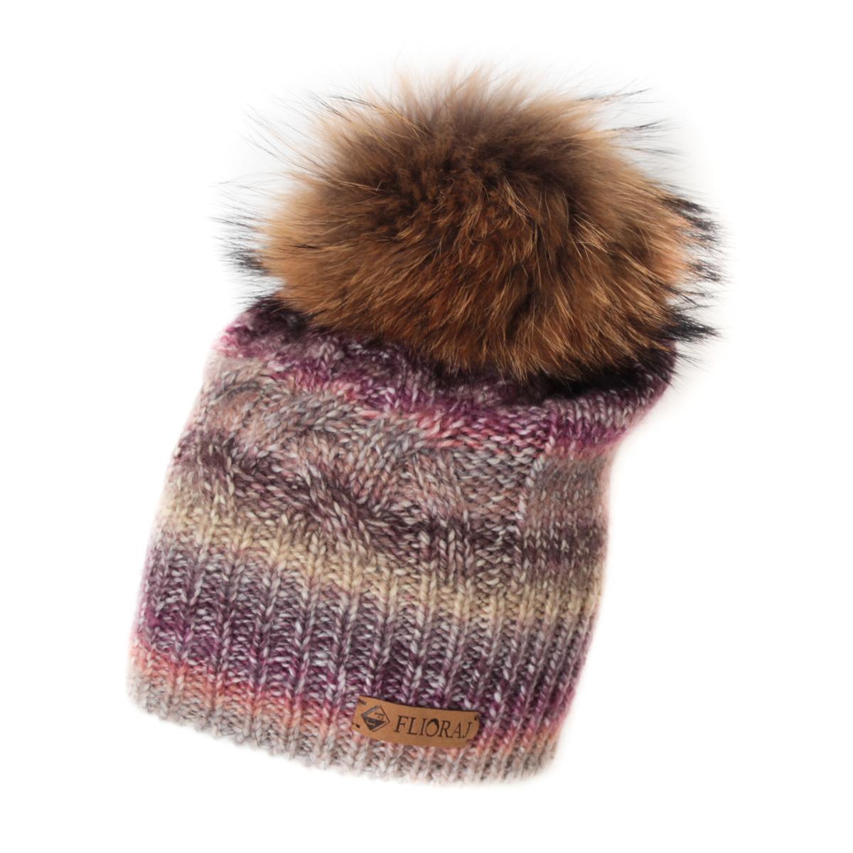 Шапка женская Flioraj, цвет: бежевый, сиреневый. 010/1FJ. Размер 56/58010/1FJСтильная теплая шапка от Flioraj, связанная из овечьей шерсти и шерсти горной альпаки, отлично согреет в холодную погоду. Состав пряжи делает изделие мягким, теплым и комфортным. Модель оригинальной смесовой расцветки выполнена рельефной вязкой, украшена нашивкой из натуральной кожи и меховым крашеным помпоном из енота. Оттенок помпона может отличаться.