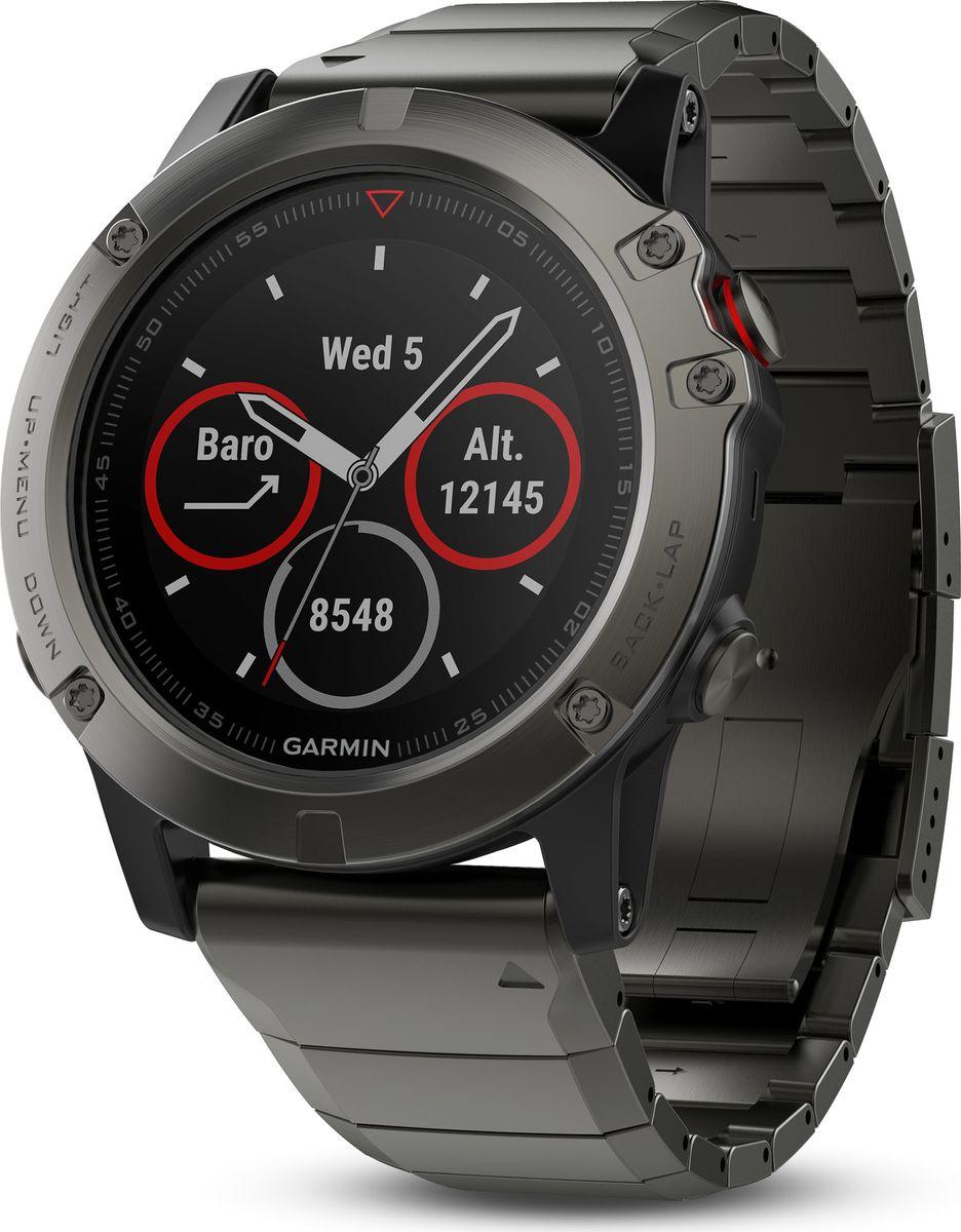 Часы спортивные Garmin Fenix 5X Sapphire, цвет: серый. 010-01733-03010-01733-03Мультиспортивные часы с GPS/ГЛОНАСС для путешествий с топографическими картамиFenix 5Х туристические часы (51мм) серые с металлическим браслетомПредустановленная топографическая картаПремиум-часы с GPS/ГЛОНАСС, мультиспортивными тренировками и встроенным оптическим пульсометром Elevate1Созданы для активных приключений: прочный корпус со стальным безелем, кнопками и задней крышкой, защита от воды 100мВиджеты, которые показывают эффективность ход тренировок доступны одним касаниемСмарт функции2 - интеллектуальные оповещения, автоматическая загрузка в интернет-сообщество Garmin Connect и персонализация через загружаемые бесплатные циферблаты и приложения из магазина Connect IQВстроенные датчики: GPS и ГЛОНАСС, 3-х осевой магнитный компас, гироскоп, термометр, барометр и барометрический высотомерСрок работы от батареи: до двух недель в режиме умных часов (зависит от настроек), до 24 часов в режиме тренировки с GPS или до 60 часов в режиме экономии UltraTracСовершенствуйтесь весь день, каждый день. Fenix 5 - это высококачественные умные GPS-часы с мультиспортом, интеллектуальными уведомлениями2 и встроенным оптическим пульсометром на запястье1. Улучшенные функции фитнеса и быстросменные ремешки, которые позволяют вам уйти с рабочего места на тренировку, без задержек. Каким бы видом спорта вы не занимались, Fenix 5 его поддерживает, благодаря встроенным профилям деятельности и показателям производительности.Две системы навигацииFenix 5 оснащен улучшенным спутниковым приемником GPS и ГЛОНАСС для отслеживания местоположения в сложных условиях. Вы можете рассчитывать на длительное время автономной работы в каждом режиме работы (конкретное время зависит от модификации часов и настроек). Защита от воды 100м позволит вам с уверенностью путешествовать везде, где захочется.Отличная читаемость на ходуЯркий полноцветный дисплей Garmin Chroma Display со светодиодной подсветкой обеспечивает отличную читаем