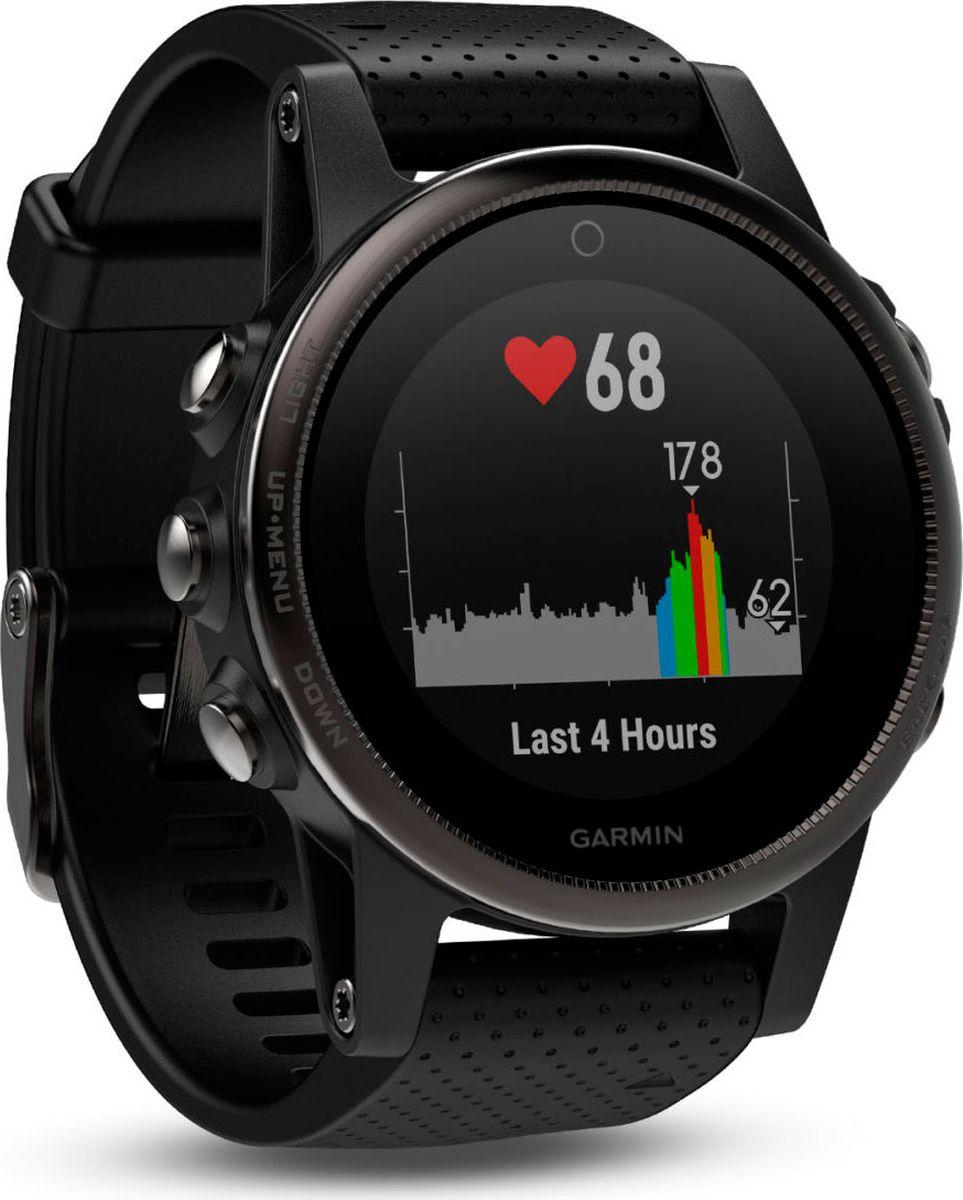 Часы спортивные Garmin Fenix 5S Sapphire, цвет: черный010-01685-11Часы с GPS/ГЛОНАСС для повседневной жизни, приключений, фитнеса и спортаFenix 5S компактные часы (42мм) черные с черным ремешкомПремиум-часы с GPS/ГЛОНАСС, мультиспортивными тренировками и встроенным оптическим пульсометром Elevate1Созданы для активных приключений: прочный корпус со стальным безелем, кнопками и задней крышкой, защита от воды 100мВиджеты, которые показывают эффективность ход тренировок доступны одним касаниемСмарт функции2 - интеллектуальные оповещения, автоматическая загрузка в интернет-сообщество Garmin Connect и персонализация через загружаемые бесплатные циферблаты и приложения из магазина Connect IQВстроенные датчики: GPS и ГЛОНАСС, 3-х осевой магнитный компас, гироскоп, термометр, барометр и барометрический высотомерСрок работы от батареи: до двух недель в режиме умных часов (зависит от настроек), до 24 часов в режиме тренировки с GPS или до 60 часов в режиме экономии UltraTracСовершенствуйтесь весь день, каждый день. Fenix 5 - это высококачественные умные GPS-часы с мультиспортом, интеллектуальными уведомлениями2 и встроенным оптическим пульсометром на запястье1. Улучшенные функции фитнеса и быстросменные ремешки, которые позволяют вам уйти с рабочего места на тренировку, без задержек. Каким бы видом спорта вы не занимались, Fenix 5 его поддерживает, благодаря встроенным профилям деятельности и показателям производительности.Две системы навигацииFenix 5 оснащен улучшенным спутниковым приемником GPS и ГЛОНАСС для отслеживания местоположения в сложных условиях. Вы можете рассчитывать на длительное время автономной работы в каждом режиме работы (конкретное время зависит от модификации часов и настроек). Защита от воды 100м позволит вам с уверенностью путешествовать везде, где захочется.Отличная читаемость на ходуЯркий полноцветный дисплей Garmin Chroma Display со светодиодной подсветкой обеспечивает отличную читаемость при любых внешних условиях. Трансфлективная технология, которая