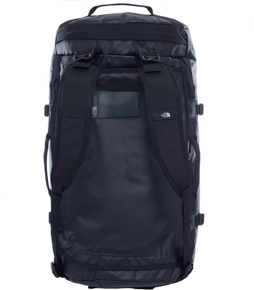 Сумка дорожная The North Face Base Camp Duffel, цвет: черный. T0CWW2JK3T0CWW2JK3Дорожная сумка The North Face Base Camp Duffel - знаменитый экспедиционный баул, который ценят по всему миру за его надежность. У сумки предусмотрен боковой карман на молнии для телефона или необходимых в пути документов, улучшенные эргономичные плечевые лямки, новые мягкие боковые ручки, которые позволяют с удобством переносить (или тащить) тяжелые грузы. Проверенная временем конструкция из нейлона баллистик все так же надежна, как и прежде. Объем: 71 л.