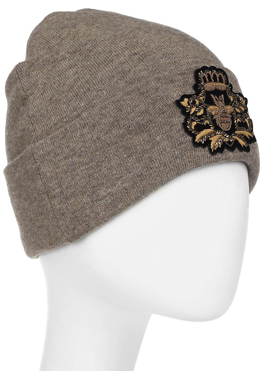 Шапка женская Level Pro Шеврон, цвет: кофейный меланж. 999101. Размер 56/58999101Женская шапка Level Pro Шеврон выполнена из высококачественной пряжи. Для комфорта и тепла внутри шапки предусмотрена мягкая флисовая подкладка. Модель украшена нашивкой.