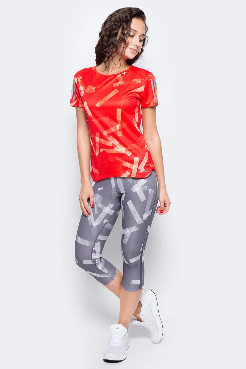 Футболка для бега женская Adidas Rs Q3 Grphc T W, цвет: красный, оранжевый. BS2895. Размер L (48/50)BS2895Женская футболка для бега Adidas изготовлена из полиэстера. Модель с круглым вырезом горловины и короткими рукавами, дополненасветоотражающими полосками. Легкая ткань climalite® отводит излишки влаги от кожи, сохраняя ощущение сухости и свежести. Модель полностью повторяет все твои движения.