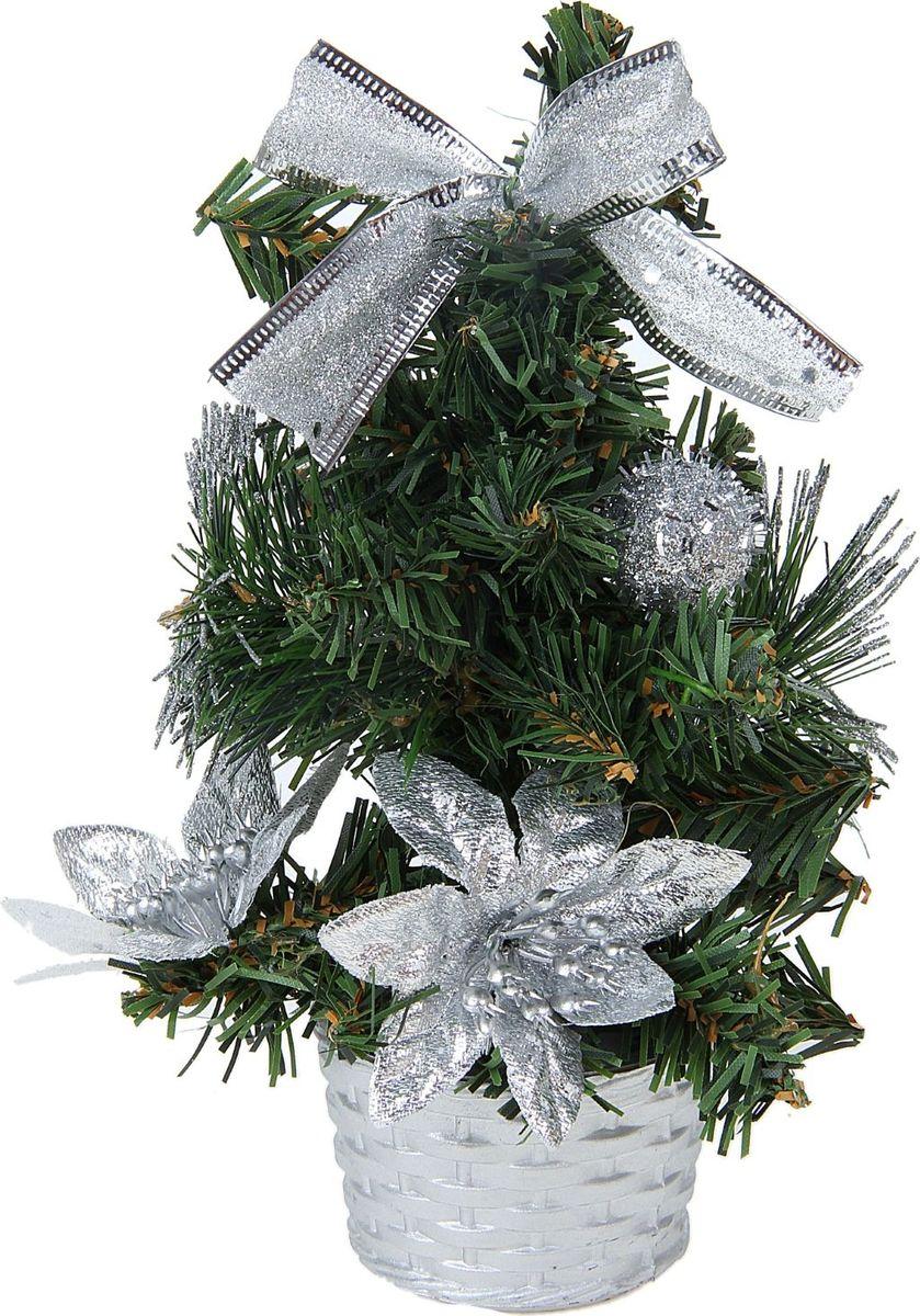 Ель искусственная Sima-land Новогодняя елочка, настольная, высота 20 см706044Блестки, бантики и цветы создадут новогоднее настроение. Такую ель не нужно украшать - она уже нарядная. А благодаря аккуратному горшочку, в который помещена елочка, она станет прекрасным украшением любого интерьера.Новый год – любимый праздник многих. В преддверии этого чудесного времени преображается все вокруг - улицы, дома и даже люди, окружающие нас. Преобразите и вы свой дом. Отличной помощницей вам в этом станет елка с серебряным декором Снежные шарики. Ель прикреплена к пластиковому горшочку.