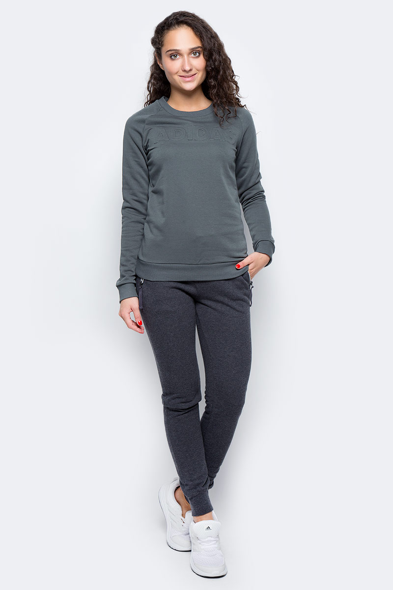 Толстовка женская Adidas Lineage Sweater, цвет: серый. CD1939. Размер XS (40/42)CD1939Женская толстовка Adidas изготовлена из хлопка с добавлением полиэстера. Модель с круглым вырезом горловины и длинными рукавами, дополнена тисненной надписью на груди. . Рукава реглан обеспечивают свободу движений. Рифленые манжеты и нижний край удерживают модель на месте.