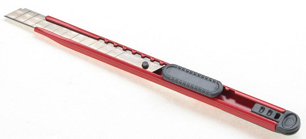 Office Force Stationery Нож канцелярский с автоблокировкой, лезвие 9 мм, цвет красный99908Нож канцелярский Office Force. Материал корпуса и направляющих - металл. С системой автоблока лезвий. Длина лезвия - 9 мм, цвет корпуса -красный. Изготовлен из высококачественной стали. Система блокирования обеспечивает неподвижность лезвия во время работы. Лазерная гравировка позволяет производить обламывание звена лезвия, четко по метке. Размер ножа - 146х22х12 мм.