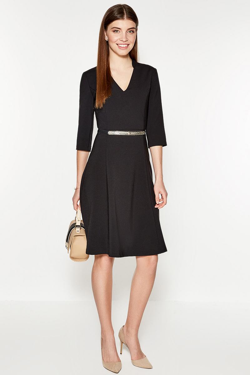 Платье Concept Club Panna, цвет: черный. 10200200333. Размер M (46)10200200333Платье от Concept Club выполнено из плотного трикотажа и декорировано V-образным вырезом, переходящим в воротник-стойку. Модель приталенного силуэта с расклешенной юбкой длины миди, сатиновой подкладкой лифа, рукавами длиной три четверти и застежкой-молнией на спинке.