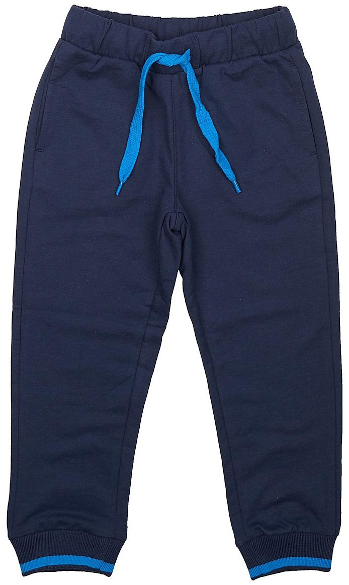 Брюки спортивные для мальчика Sela, цвет: темно-синий. Pk-715/110-7331. Размер 104Pk-715/110-7331Спортивные брюки для мальчика от Sela выполнены из хлопкового трикотажа. Модель на талии дополнена широкой эластичной резинкой со шнурком. Брючины имеют широкие трикотажные манжеты. По бокам брюки дополнены втачными карманами.