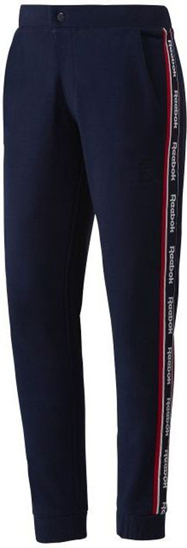 Брюки спортивные женские Reebok F Snap Pant, цвет: темно-синий. BR7458. Размер S (42/44)BR7458Спортивные брюки от Reebok выполнены из мягкого хлопкового трикотажа. Модель зауженного кроя, брючины по низу дополнены широкими манжетами. В поясе брюки застегиваются на кнопку и имеют ширинку на молнии, имеются два кармана по бокам, один карман сзади.