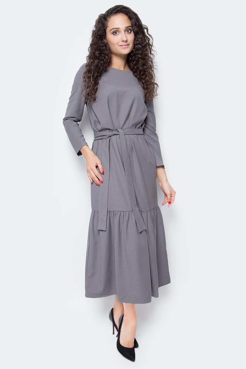 Платье Baon, цвет: серый. B457501_Zircon Melange. Размер XS (42)B457501_Zircon MelangeБыть ни на кого не похожей, проявлять свою индивидуальность и безупречный вкус - в таком наряде вы легко справитесь с поставленной задачей! Платье от Baon миди-длины имеет прямой крой и широкую оборку, расположенную вдоль нижней части изделия. При желании вы сможете создать приталенный силуэт, используя завязывающийся пояс. Платье имеет два кармана по бокам.