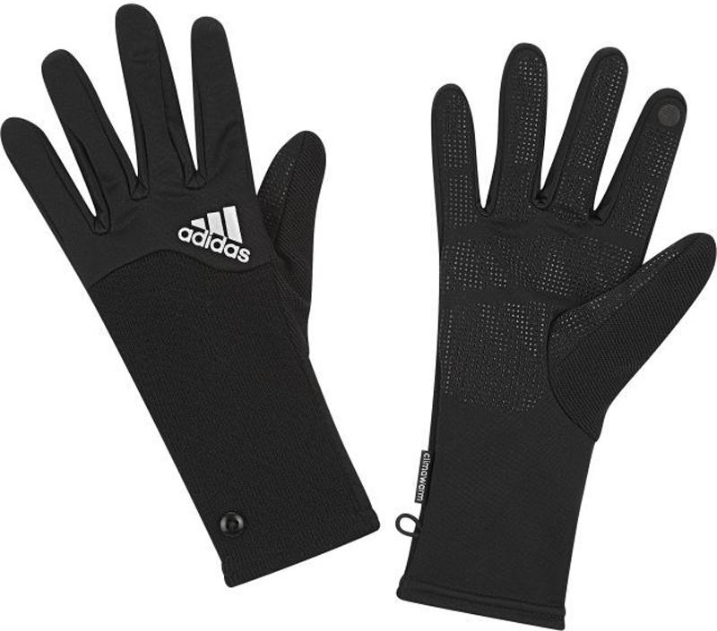 Перчатки для бега женские Adidas R Clmwm W Glove, цвет: черный. S94161. Размер M (20)S94161В перчатках от adidas руки будут в тепле во время пробежек в холодную погоду. Дышащая технология climawarm эффективно согревает. Силиконовый узор на ладонях обеспечивает оптимальное сцепление. Флисовые вставки на кончиках пальцев созданы для использования мобильных устройств с сенсорными экранами без снимания перчаток.Дышащая технология climawarm сохраняет максимум естественного тепла тела даже при отрицательной температуре. Рифленые манжеты оформлены декоративными пуговицами. Перчатки дополнены светоотражающими элементами для безопасности в темное время суток.
