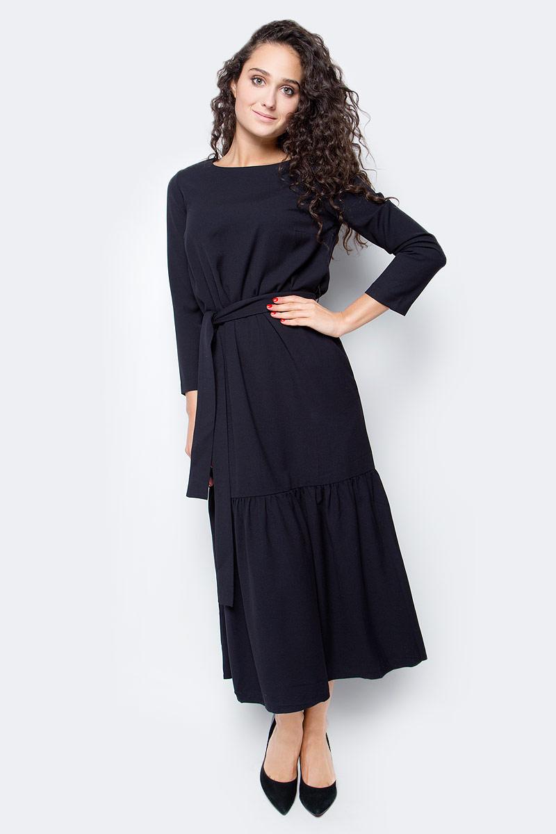 Платье Baon, цвет: черный. B457501_Black. Размер S (44)B457501_BlackБыть ни на кого не похожей, проявлять свою индивидуальность и безупречный вкус - в таком наряде вы легко справитесь с поставленной задачей! Платье от Baon миди-длины имеет прямой крой и широкую оборку, расположенную вдоль нижней части изделия. При желании вы сможете создать приталенный силуэт, используя завязывающийся пояс. Платье имеет два кармана по бокам.
