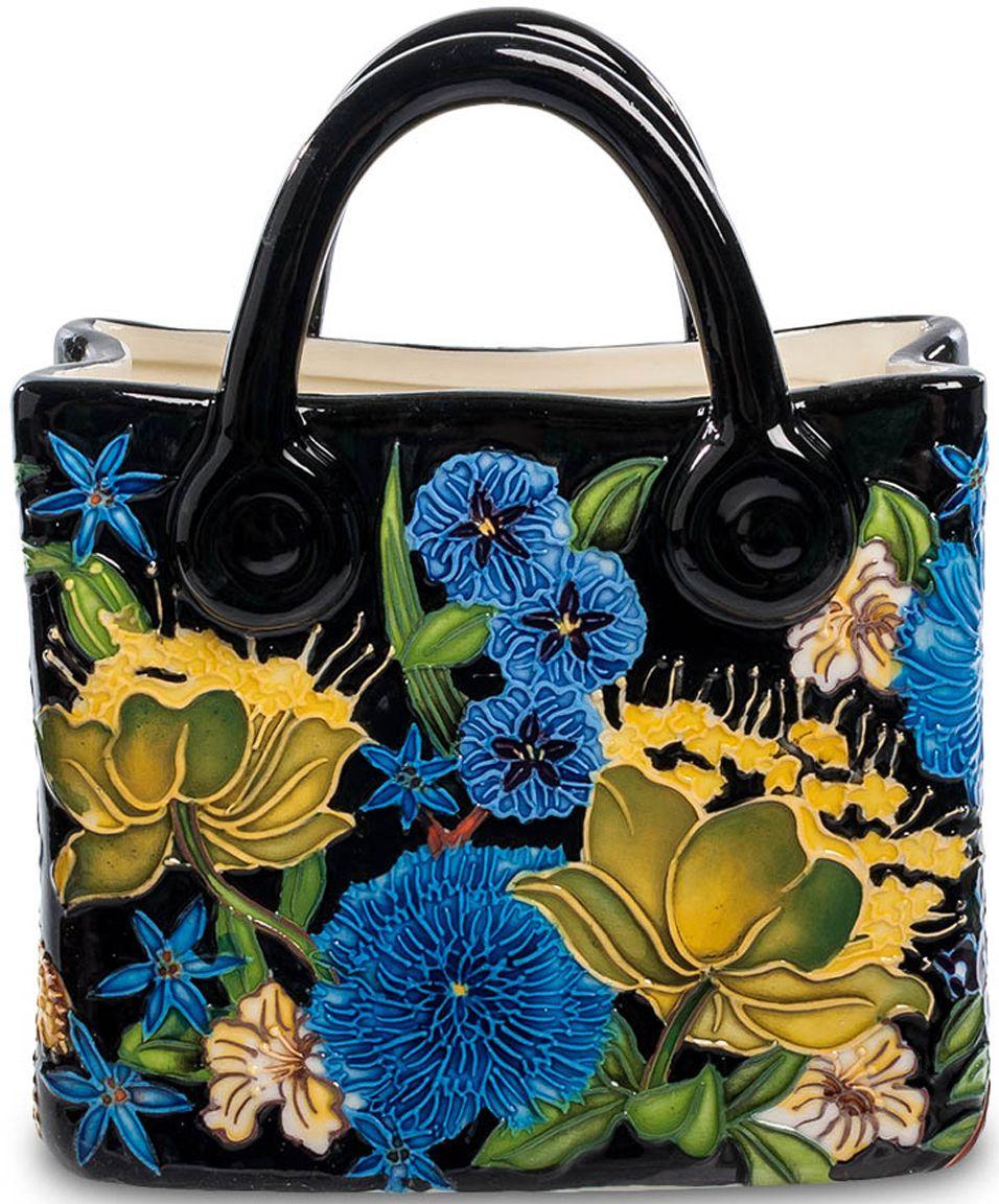 Ваза-кашпо Pavone Сумочка, высота 16 смJP-670/ 2Интересная ваза-кашпо Pavone Сумочка очень напоминает женскую сумочку. Ее изысканность подчеркнута интересной расцветкой, которая ассоциируется с красками лета. Для изготовления кашпо использовался фарфор, основной цвет вазы – черный, на котором гармонично расцвели ярко-голубые и желтые цветы, которыми оформлено ее основание.
