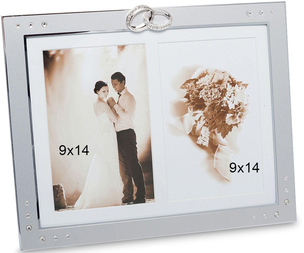Фоторамка Bellezza Casa Счастливый день, на 2 фото: 9х14. CHK-070CHK-070Фоторамка на 2 фото для фотографий 9х14 см.Стильная и изящная фоторамка Счастливый день создана специально для того, чтобы дополнить красоту ваших самых любимых снимков. Это изделие рассчитано на две фотографии, что позволит создать своеобразный коллаж вашей любви. Фоторамка украшена декором в виде блестящих камней и обручальных колец, которые словно подчеркивают, что истинная любовь бессмертна. Благодаря белому фону и серебристому оформлению фоторамки, ваши свадебные фотографии будут казаться еще более красивыми и нежными.