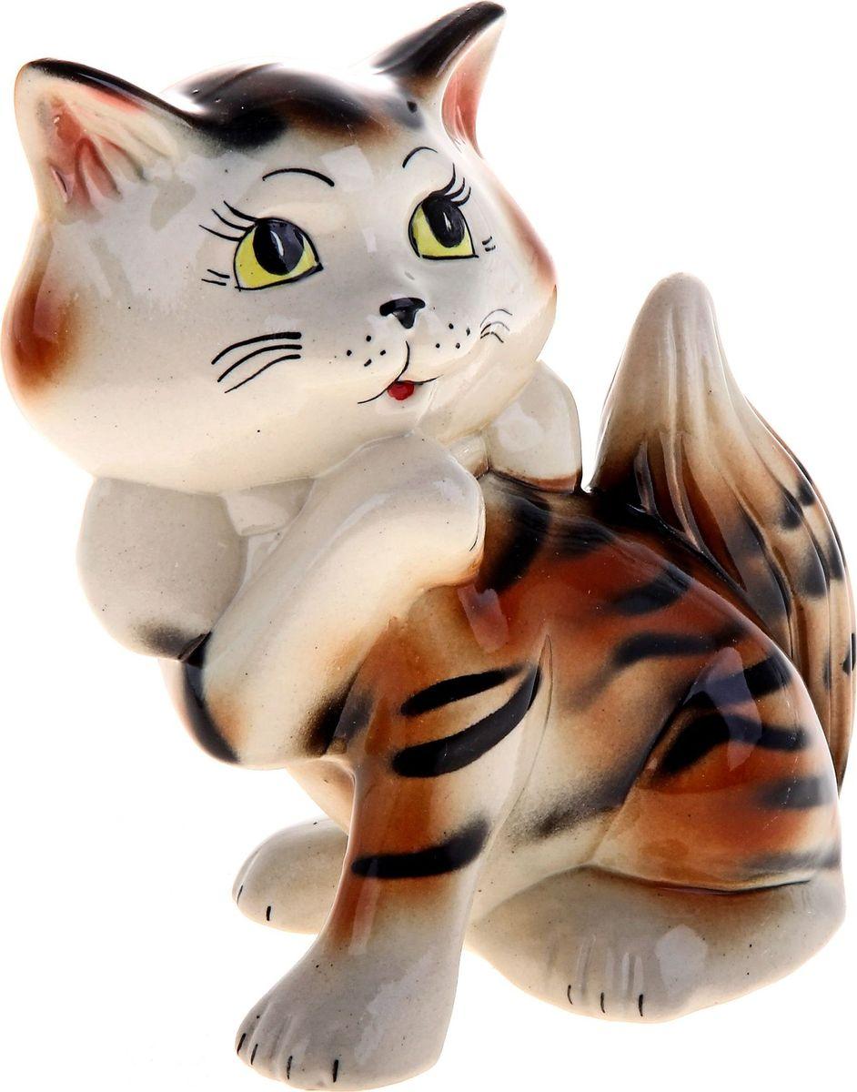 Копилка Керамика ручной работы Кошка Милка, 11 х 18 х 20 см165906Женщины любят баловать себя покупками для красоты и здоровья. С помощью такой копилки можно незаметно приблизиться к приобретению желаемого. Образ кошки всегда олицетворял привлекательность и символизировал домашнее спокойствие. Поставьте изделие возле предметов роскоши, и оно будет способствовать их преумножению.