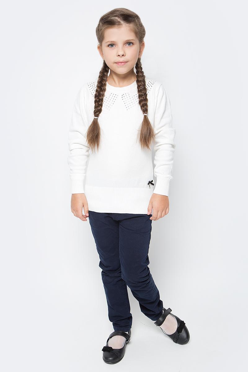 Джемпер для девочки Luminoso, цвет: молочный. 728011. Размер 122728011Джемпер для девочки Luminoso выполнен из хлопка с добавлением нейлона. Модель имеет длинные рукава и круглый вырез горловины. Манжеты рукавов, горловина и низ джемпера отделаны эластичной резинкой. Изделие на груди декорировано стразами, низ дополнен бантиком с подвеской.