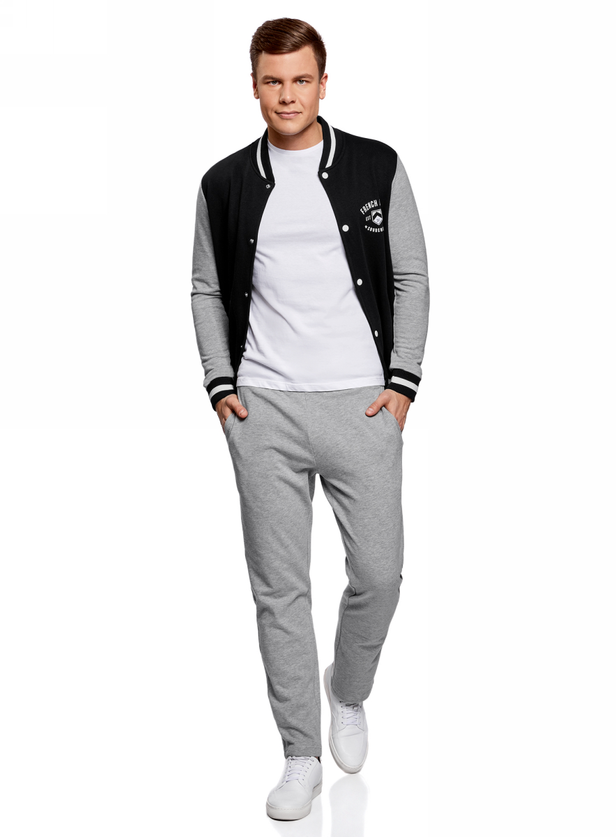 Брюки спортивные мужские oodji Basic, цвет: серый. 5B230001M/47829N/2300M. Размер XS (44)5B230001M/47829N/2300MСпортивные брюки от oodji выполнены из хлопкового трикотажа. Модель с эластичной резинкой на талии и затягивающимся шнурком по бокам дополнена втачными карманами, сзади имеется накладной карман.