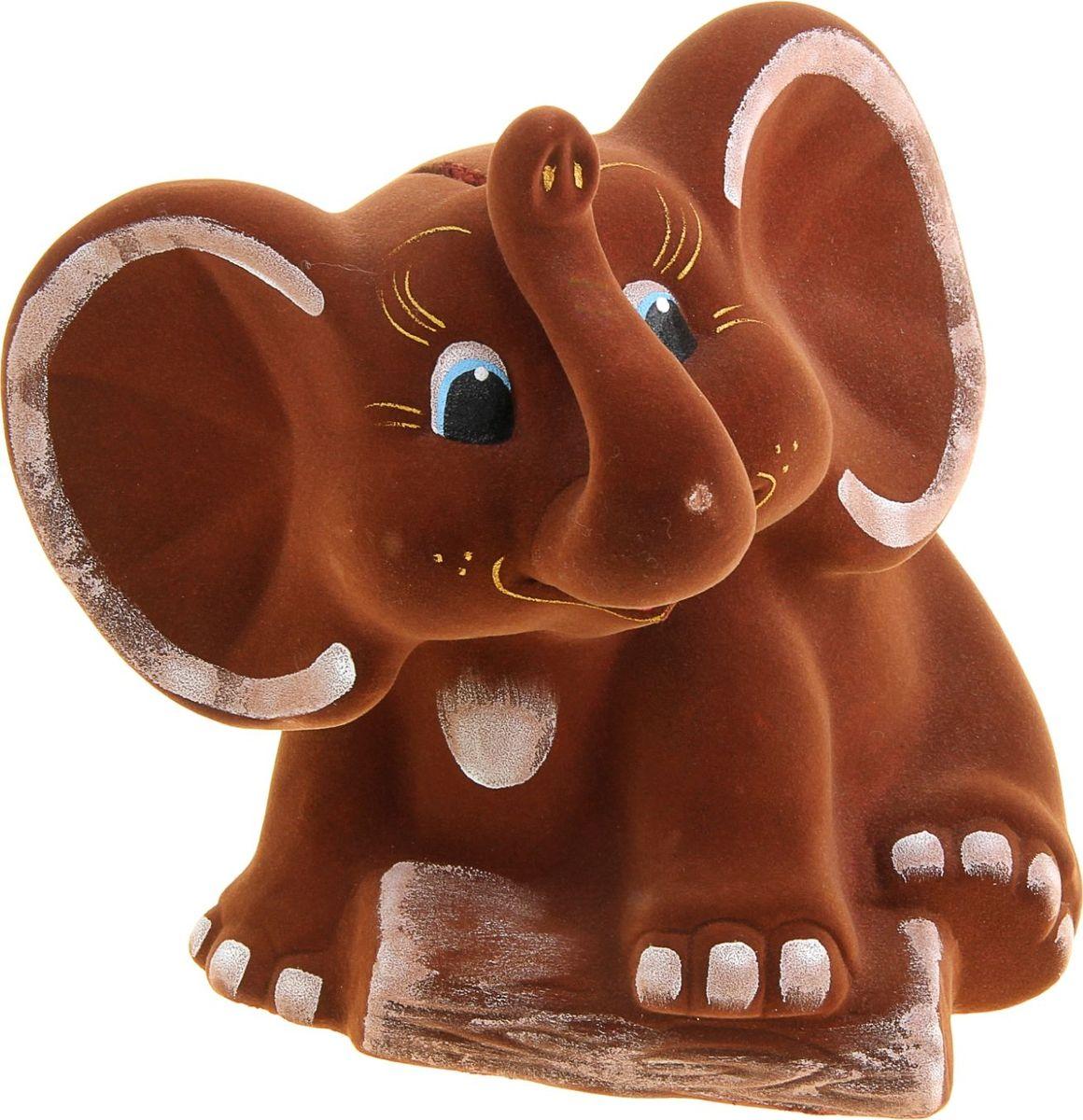 Копилка Керамика ручной работы Слон, 20 х 24 х 25 см1007134Мечтаете накопить на отпуск? Поставьте себе цель, кидайте в копилку купюры покрупнее и вперёд! Слон олицетворяет мудрость, неуязвимость и надёжность. Это животное обладает невероятной силой, но одновременно является терпеливым и миролюбивым. Изделие в виде этого млекопитающего сохранит в доме любовь и поможет улучшить благосостояние.Обращаем ваше внимание, что копилка является одноразовой.