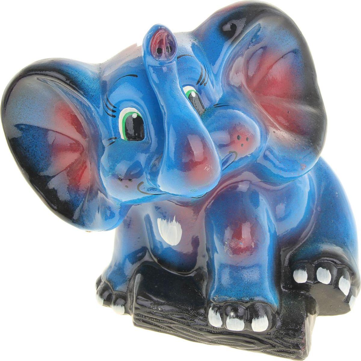 Копилка Керамика ручной работы Слон, 23 х 18 х 24 см1049490Мечтаете накопить на отпуск? Поставьте себе цель, кидайте в копилку купюры покрупнее и вперёд! Слон олицетворяет мудрость, неуязвимость и надёжность. Это животное обладает невероятной силой, но одновременно является терпеливым и миролюбивым. Изделие в виде этого млекопитающего сохранит в доме любовь и поможет улучшить благосостояние.Обращаем ваше внимание, что копилка является одноразовой.