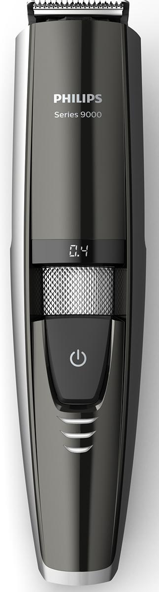 Philips BT9297/15 триммер с лазером для максимально точного подравниванияBT9297/15Создайте идеальные контуры бороды, используя нашу первоклассную систему лазерного наведения. Следуйте траектории красной световой линии, чтобы симметрично подровнять волоски с обеих сторон лица.Лазерное наведение для неизменно точного, симметричного подравниванияСоздайте идеальные контуры бороды, используя нашу первоклассную систему лазерного наведения. Следуйте траектории красной световой линии, чтобы симметрично подровнять волоски с обеих сторон лица. Металлические лезвия с двойной заточкой для быстрого подравниванияНаши прочные металлические лезвия с двойной заточкой срезают даже самые густые волоски и прослужат вам в течение долгого времени. В процессе подравнивания лезвия самостоятельно затачиваются, слегка касаясь друг друга. Точное моделирование и ровные линии — раз за разом. Приподнимает и направляет волоски к лезвию для равномерного подравнивания без усилийПодравнивайте щетину одним движением: наша инновационная система Lift&Trim приподнимает каждый волосок и направляет их все к лезвиям из нержавеющей стали с двойной заточкой. Результат — ровная щетина и подравнивание всего одним движением. 80 минут работы после зарядки в течение 1 часа или питание от сетиЗарядка триммера для бороды с помощью нашего усовершенствованного литий-ионного аккумулятора в течение 1 часа обеспечивает 80 минут автономной работы. Если вам необходима длительная обработка, просто подключите триммер к сети. Триммер может работать как в беспроводном режиме, так и от сети электропитания. Точное подравнивание до длины 0,4–7 мм с шагом 0,2 ммМоделируйте максимально четкие линии бороды, выбирая длину волосков с точностью до 0,2 мм. Используйте регулятор для выбора и фиксации желаемой длины — от 0,4 до 7 мм. На светодиодном дисплее четко отображается установка длиныПоверните регулятор, чтобы отобразить выбранную установку длины в миллиметрах на светодиодном дисплее. Быстрый просмотр состояния заряда аккумулятора