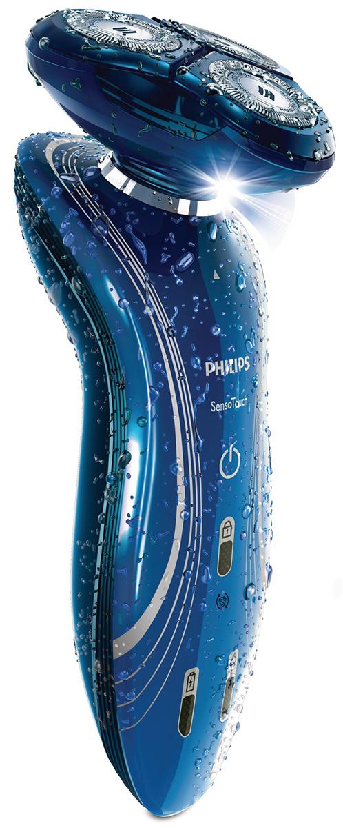 Philips SensoTouch RQ1155/16 электробритваRQ1155/16Электробритва Philips SensoTouch RQ 1155/16 создана специально для комфортного сухого и освежающего влажного бритья.Philips RQ-1155/16 состоит из трех вращающихся дисков, которые закрывают острые бритвенные лезвия. Электробритва за один подход тщательно убирает волосяной покров, особенно короткие волоски, оставляя кожу чистой и неповрежденной. Вы можете практиковать два способа бритья: влажный с применением воды или пены, и сухой – без вышеперечисленных средств. Такая особенность делает ее удобной и многофункциональной, а также предполагает использование в обычных и походных условиях.Электробритва оснащена триммером, который формирует и поддерживает определенную длину и форму волосяного покрова на лице, шее и висках, таким образом создавая ваш собственный стиль.Плавающие головки точно повторяют и огибают контуры лица и шеи, позволяя за один подход удалить или подровнять волосы даже в труднодоступных местах.Встроенный аккумулятор электробритвы способен проработать в разных режимах без зарядки около50 мин. Это очень удобно и позволяет вам выглядеть ухоженным даже при частом ее использовании, и при этом не тратить много времени на зарядку. Прибор оснащен функцией быстрой зарядки, которая в среднем за 5 минут позволяет подзарядить аккумулятор для одного сеанса бритья.