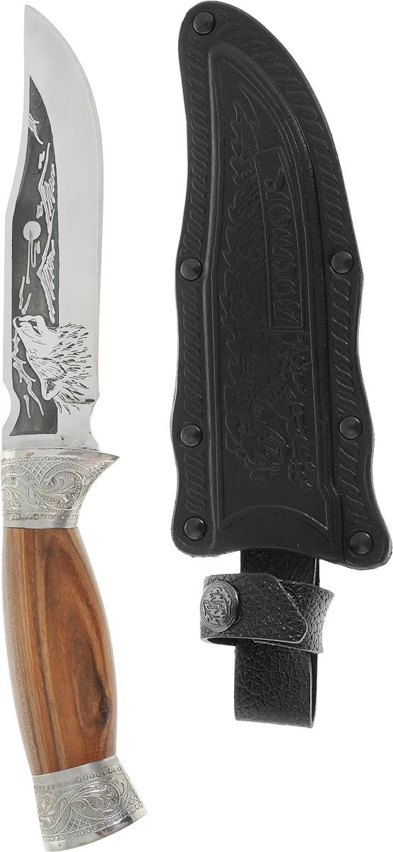 Нож туристический Кизляр Восток, длина клинка 15 см. 12254681225468Нож туристический Кизляр Восток сочетает современные технологии обработки материалов и традиции художественного оформления высочайшего мастерства. Лезвие ножа выполнено из стали 65Х13 и дополнено рисунком. Рукоятка изготовлена из дерева и украшена металлическими частями с резьбой. Нож предназначен для использования в качестве режущего инструмента в туристических походах, на привалах, в быту. Небольшой городок Кизляр, расположенный на границе Дагестана и Чечни, известен не только своими коньяками, но и искусными ножами и кинжалами. Народные умельцы из поколения в поколение изготавливают клинки, получившие со временем мировую известность благодаря эталонному качеству и стилю.Кизлярские ножи - не просто игрушки, это желанное и статусное приобретение для многих мужчин. Эти ножи станут и надежными помощниками в деле, и замечательными сувенирами в коллекцию оружия.Для хранения предусмотрены ножны, которые можно прикрепить к ремню с помощью специальной петли. Длина ножа: 27,5 см.