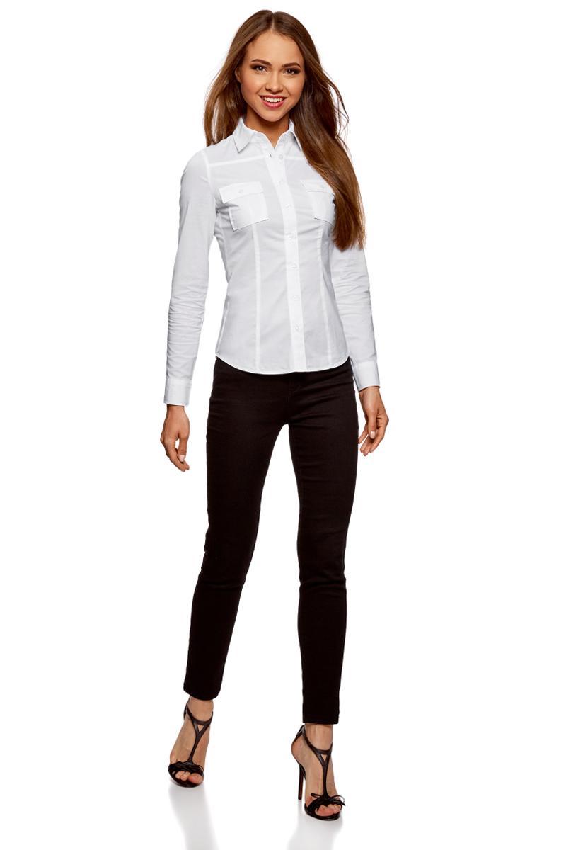 Рубашка женская oodji Ultra, цвет: белый. 11442121-5B/43609/1000N. Размер 44-170 (50-170)11442121-5B/43609/1000NСтильная блузка oodji изготовлена из натурального хлопка и застегивается на пуговицы. Модель выполнена с отложным воротничком и длинными рукавами. Манжеты рукавов дополнены застежками-пуговицами. Спереди блузки имеются накладные карманы.