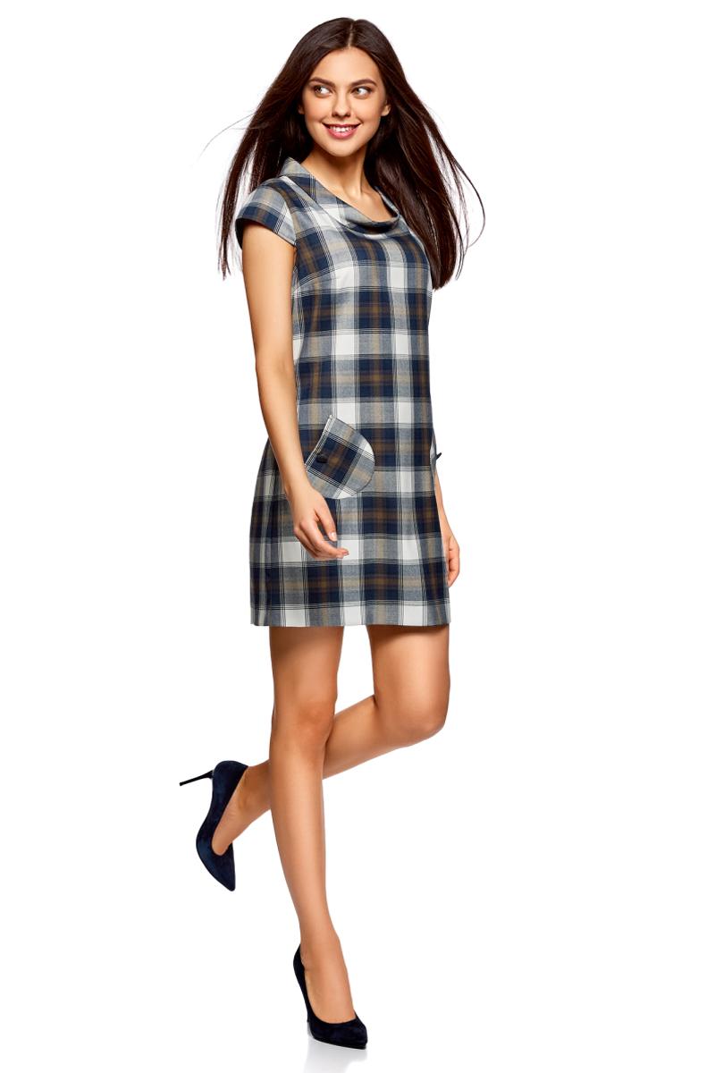 Платье oodji Ultra, цвет: белый, синий. 12C03001/37812/1279C. Размер 40-170 (46-170)12C03001/37812/1279CСтильное платье прямого кроя с короткими рукавами. У модели небольшой воротник-хомут и два накладных закругленных кармана на пуговицах. Короткое платье прямого силуэта красиво сидит на любой фигуре.