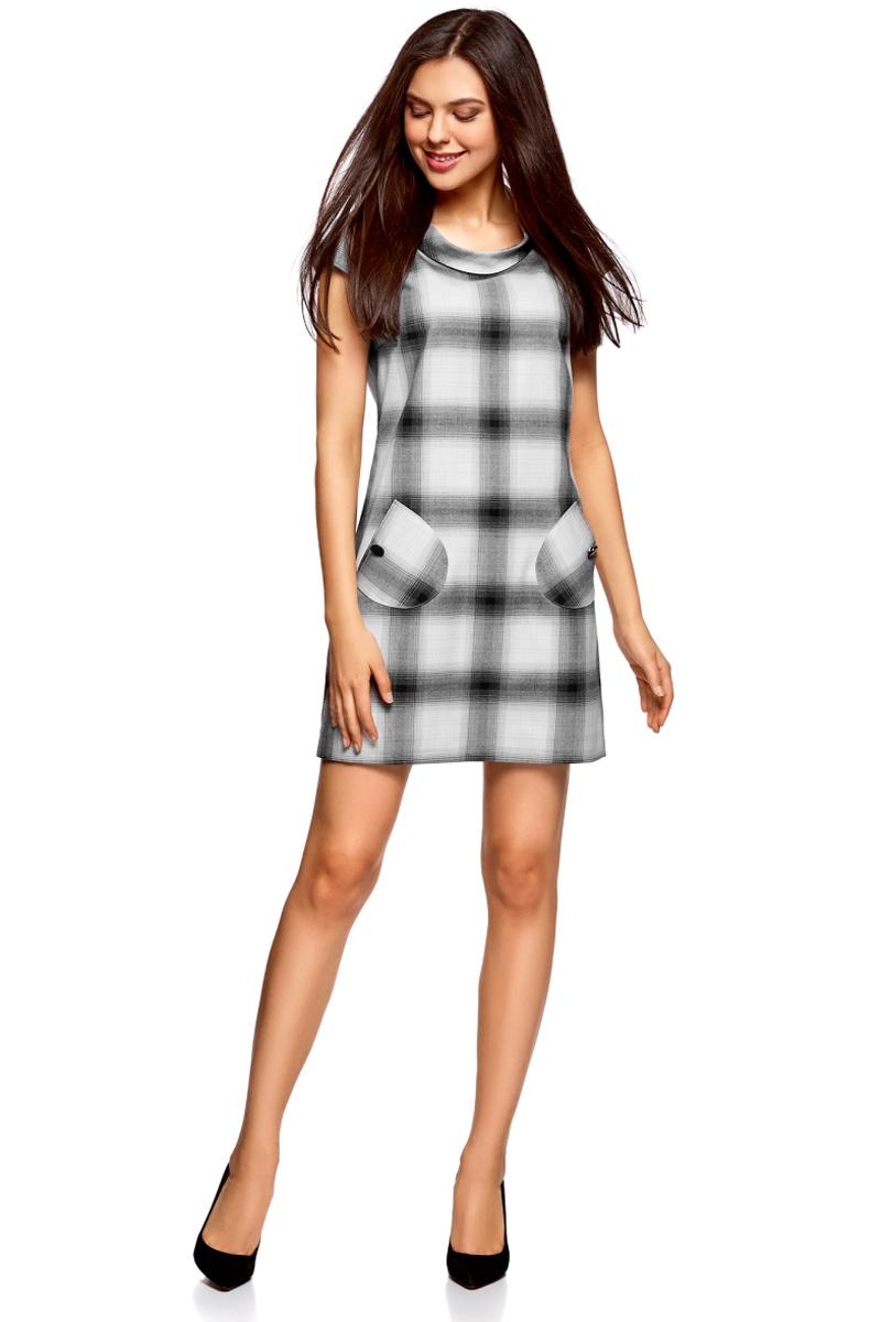 Платье oodji Ultra, цвет: черный, белый. 12C03001/37812/2912C. Размер 34-170 (40-170)12C03001/37812/2912CСтильное платье прямого кроя с короткими рукавами. У модели небольшой воротник-хомут и два накладных закругленных кармана на пуговицах. Короткое платье прямого силуэта красиво сидит на любой фигуре.