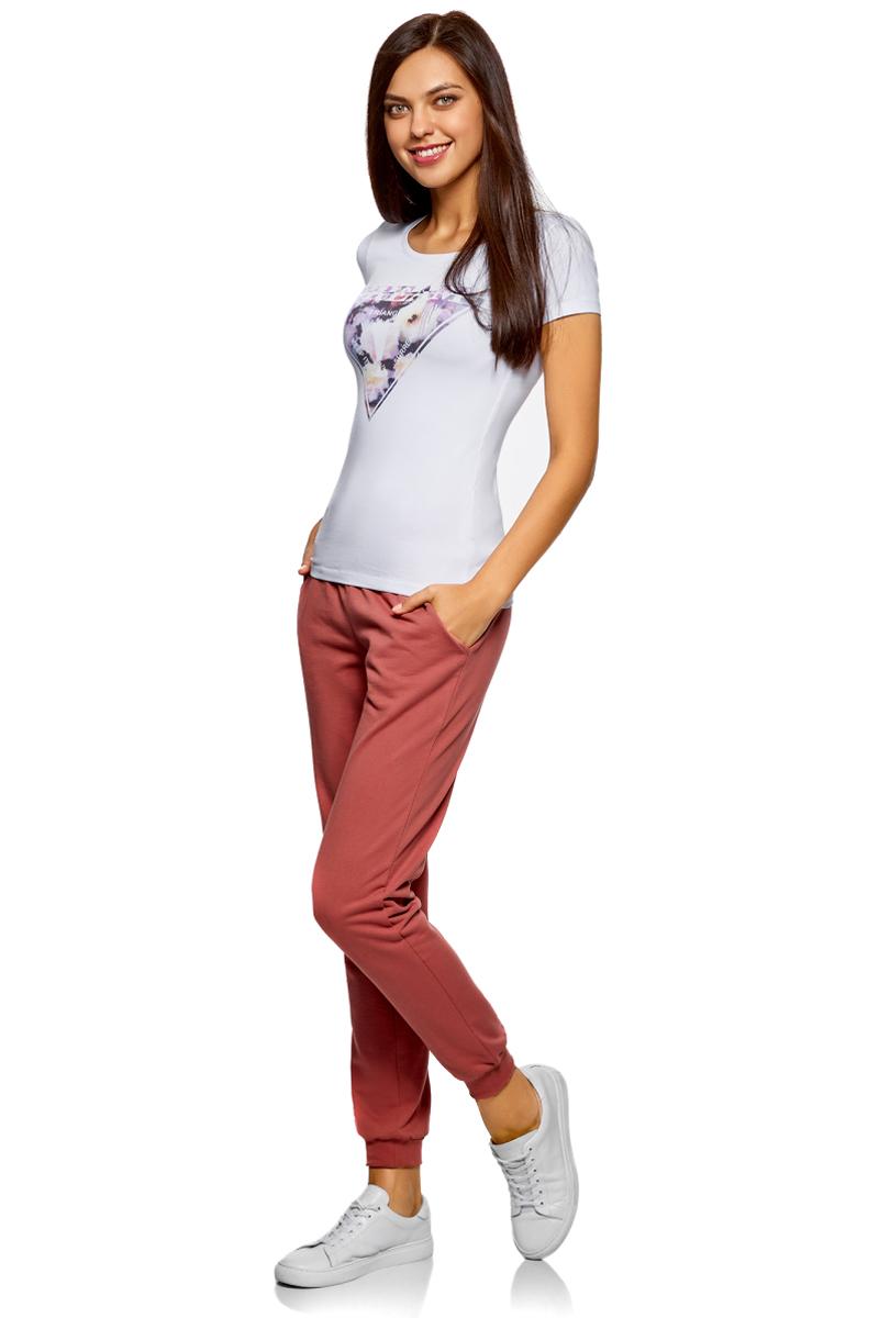 Брюки спортивные женские oodji Ultra, цвет: розовый. 16700030-5B/46173/4B00N. Размер XL (50)16700030-5B/46173/4B00NЖенские спортивные брюки oodji Ultra, выполненные из натурального хлопка, великолепно подойдут для отдыха и занятий спортом. Модель дополнена широкими эластичными резинками на поясе и по низу брючин. Объем талии регулируется с внешней стороны при помощи шнурка-кулиски. Спереди имеются два втачных кармана.