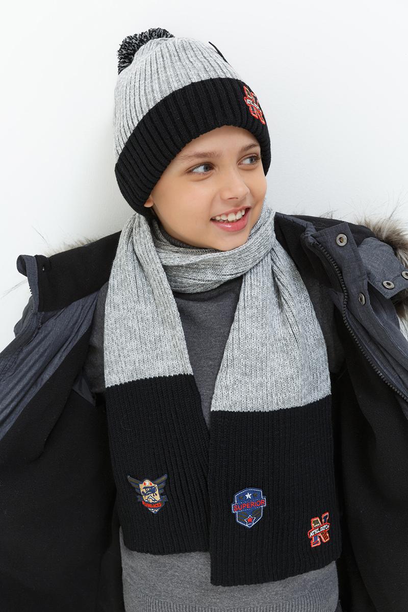 Шарф для мальчика Acoola Nuto, цвет: светло-серый, черный. 20106440018. Размер универсальный20106440018Шарф для мальчика от Acoola выполнен из натурально акриловой пряжи. Такой стильный двухцветный шарф согреет вашего ребенка и зимой и осенью.