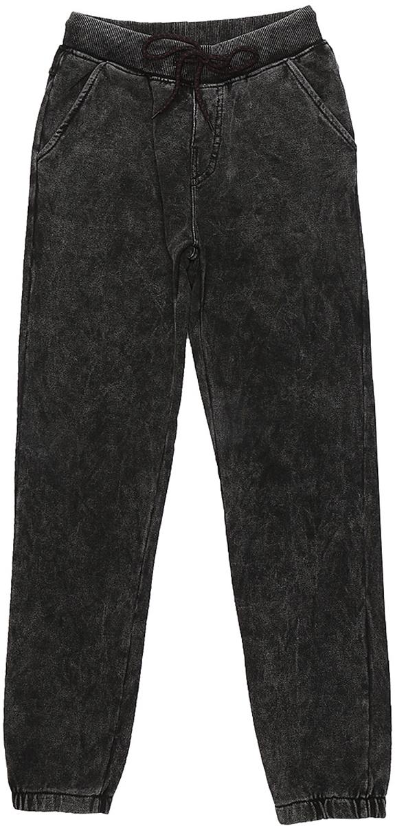 Брюки спортивные для мальчика Luminoso, цвет: темно-серый. 737014. Размер 134737014Спортивные брюки для мальчика выполнены из эластичного хлопка. Эластичный пояс дополнен шнурком для регулирования объема по талии. Спереди брюки дополнены двумя врезными карманами. Низ брючин на резинке.