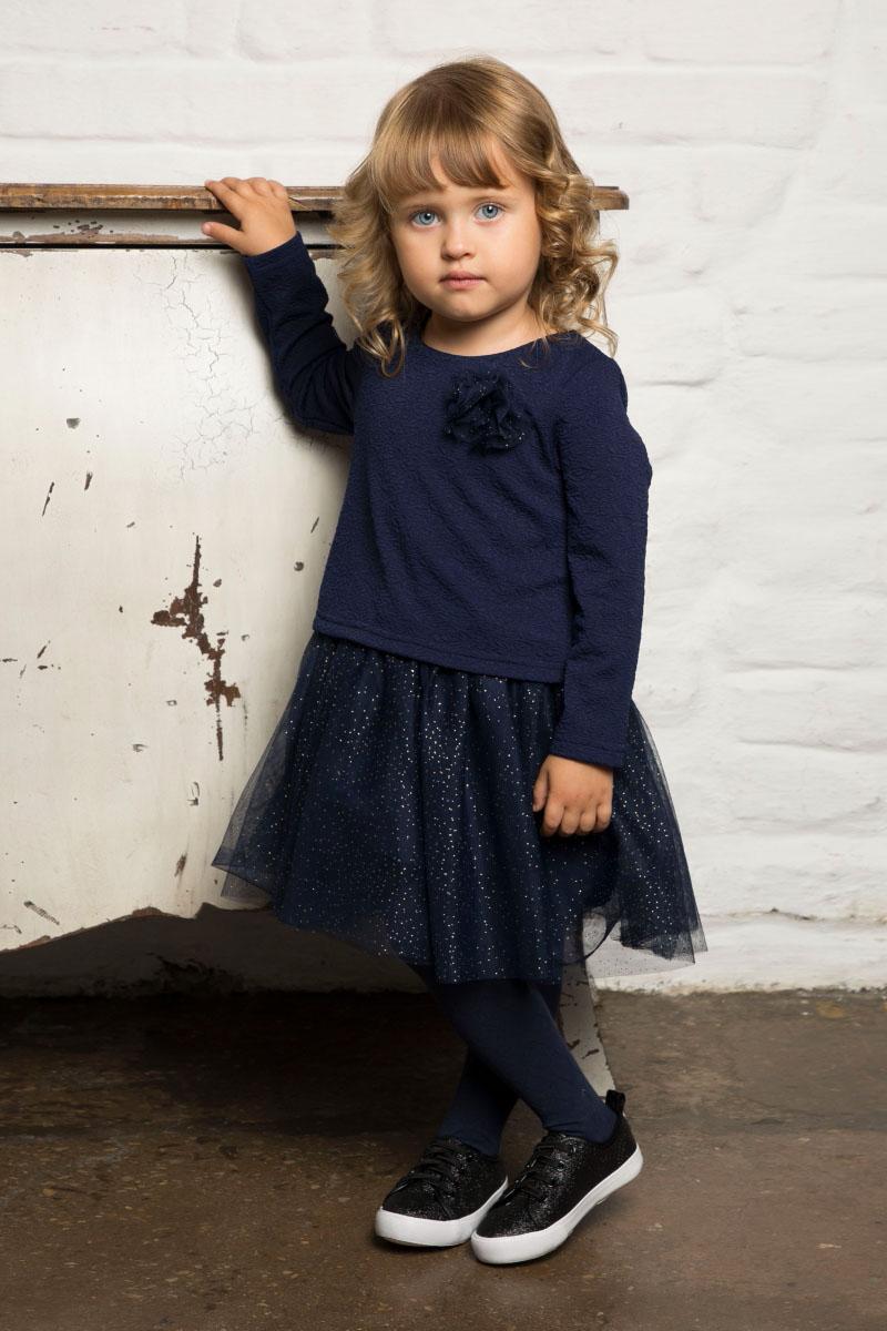 Платье для девочки Sweet Berry Baby, цвет: темно-синий. 732051. Размер 98732051Стильное платье для девочки Sweet Berry Baby выполнено из полиэстера с хлопковой подкладкой. Модель с круглым вырезом горловины и длинными рукавами декорирована цветком и фатиновой юбочкой с блестками. На спинке расположена застежка на кнопки.
