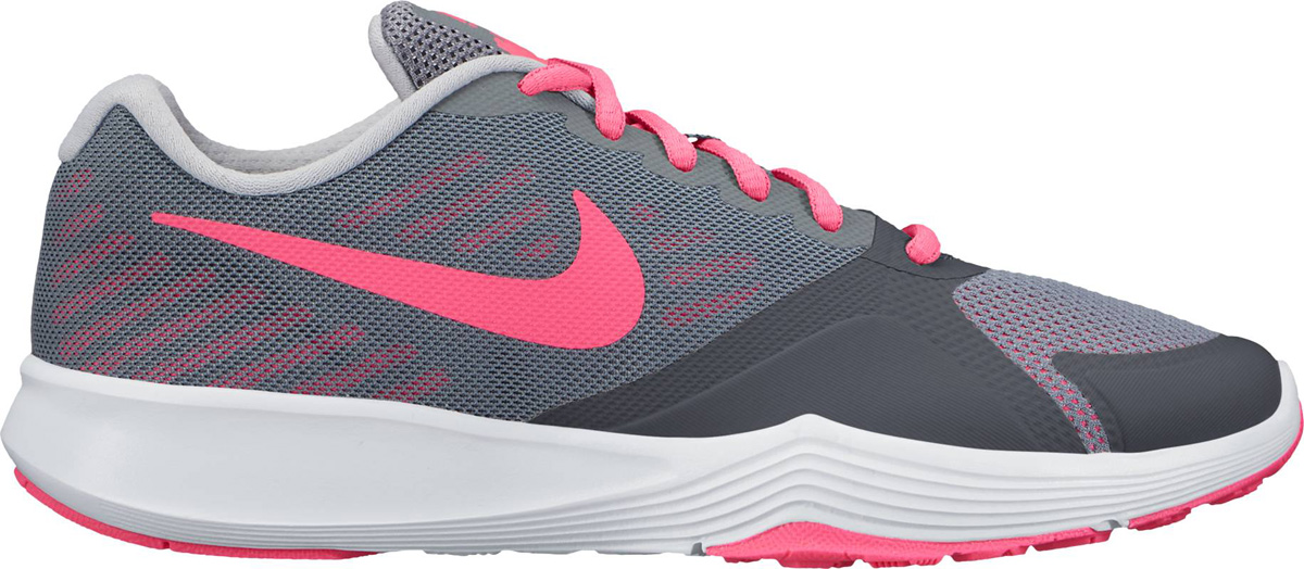 Кроссовки женские Nike City Trainer Shoe, цвет: серый, розовый. 909013-003. Размер 8 (39)909013-003Стильные женские кроссовки Nike, выполненные из текстиля и пластика, дополнены фирменной нашивкой на язычке. Шнуровка на подъеме надежно зафиксирует обувь на ноге. Внутренняя поверхность и стелька выполнены из текстиля, комфортны при движении. Эти кроссовки созданы с непревзойденной функциональностью в движении. Они идеально подходят для циклических и интенсивных кардиотренировок. Верх из однослойной сетки для воздухопроницаемости без утяжеления. Подошва обеспечивает легкость, амортизацию, гибкость и стабилизацию. Резиновые накладки в ключевых зонах обеспечивают прочность и сцепление при движении в любом направлении. Удобная стелька создает дополнительную амортизацию. Эластичные желобки в передней части стопы для повышенной гибкости в области носка. Подошва с рифлением обеспечивает отличное сцепление на любой поверхности. Мягкие и удобные, кроссовки превосходно подчеркнут ваш спортивный образ и подарят комфорт.