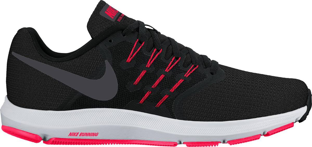 Кроссовки женские Nike Run Swift Running Shoe, цвет: черный. 909006-006. Размер 8,5 (40)909006-006Женские беговые кроссовки Nike, выполненные из текстиля и пластика, дополнены фирменной нашивкой на язычке. Интегрированные нити Flywire надежно фиксируют среднюю часть стопы, а пеноматериал создает амортизацию.Конструкция из сетки обеспечивает зональную вентиляцию и поддержку. Шнурки с интегрированными нитями для регулируемой поддержки. Подошва с вафельным рисунком повышает амортизацию и упругость. Широкая передняя часть стопы не стесняет движений пальцев. Пеноматериал Cushlon обеспечивает мягкую, но упругую амортизацию и поддержку. Сетка с открытыми отверстиями в передней части стопы для легкости и воздухопроницаемости. Сетка с плотным плетением на боковой части создает надежную поддержку, не жертвуя воздухопроницаемостью. Подошва с рифлением обеспечивает отличное сцепление на любой поверхности. Мягкие и удобные кроссовки превосходно подчеркнут ваш спортивный образ и подарят комфорт.
